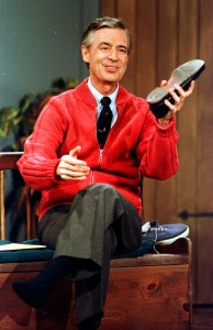 """**FILE**  Fred Rogers rehearses the opening of his PBS show """"Mister Rogers' Neighborhood"""" during a taping in this June 28, 1989 file photo, in Pittsburgh. The media company behind the PBS hit """"Mister Rogers' Neighborhood"""" is working on a new children's television series.  Kevin Morrison, chief operating officer of Family Communications Inc., told the Pittsburgh Post-Gazette the company is in talks with producers of several children's TV shows about a new program. Production of """"Mister Rogers' Neighborhood"""" ended in 2000, and Fred Rogers, the show's star, died in 2003, at age 74.           (AP Photo/Gene J. Puskar, FILE)"""